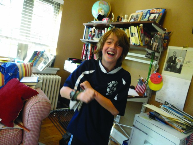 10-year-old Gabe Fleisher in his office.