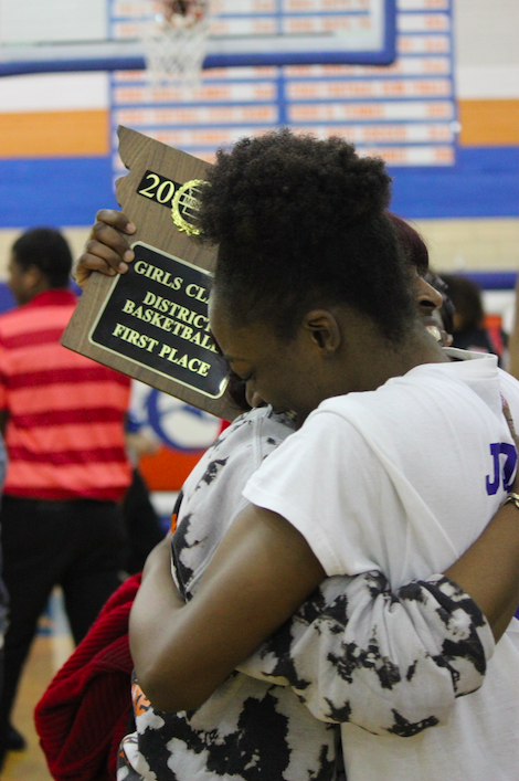 Jones+and+her+mother+embrace+after+the+Lady+Greyhounds+district+championship+win.