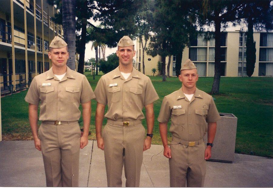 Brad+Krone+%28center%29+and+two+of+his+comrades+stand+outside+a+Naval+Base+in+San+Diego.+Photos+from+Krone.%0A