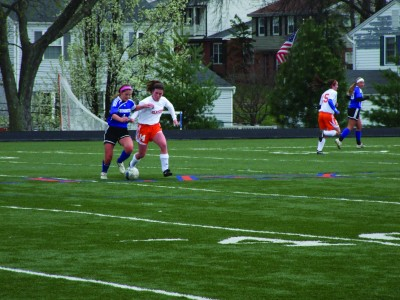 Senior Alison Bayly fights for the ball against Westminster. The Hounds defeated Westminster 2-1. (Claire Bliss)