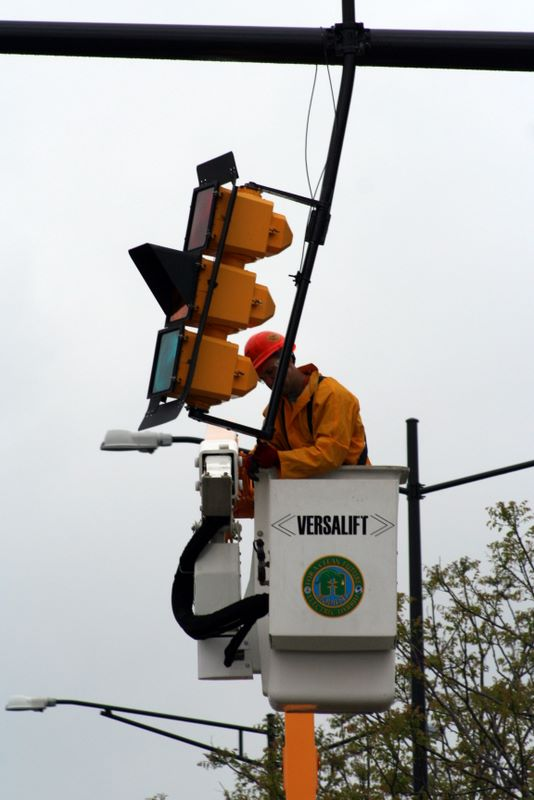 Slowly, traffic light by traffic light, the city is being restored; meanwhile, however, the residents live on without electricity as they recover from the unforgiving tempest.