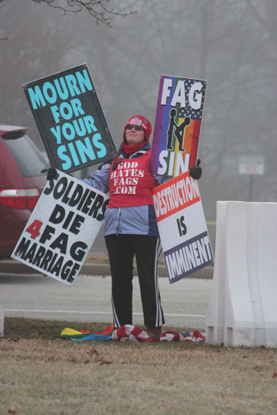 A Westboro Baptist Church member protests the Gay-Straight Alliance at CHS.
