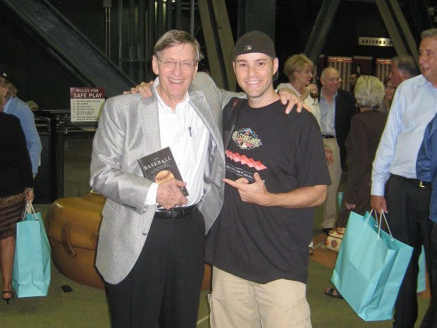 Hample with baseball commisioner Bud Selig. Selig is holding Hample's third book. Photo from Zack Hample.