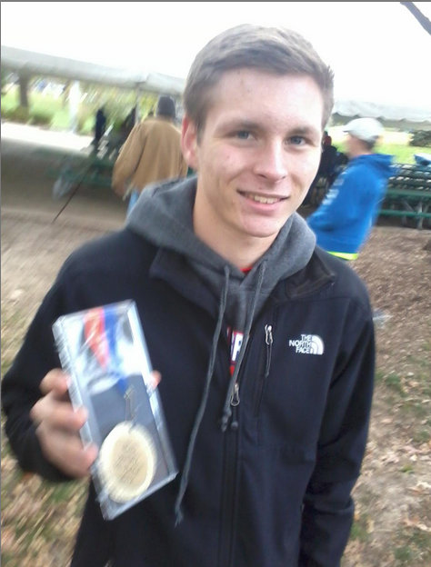 Matthew Garrett smiles with his ninth place medal. (Peter Baugh)