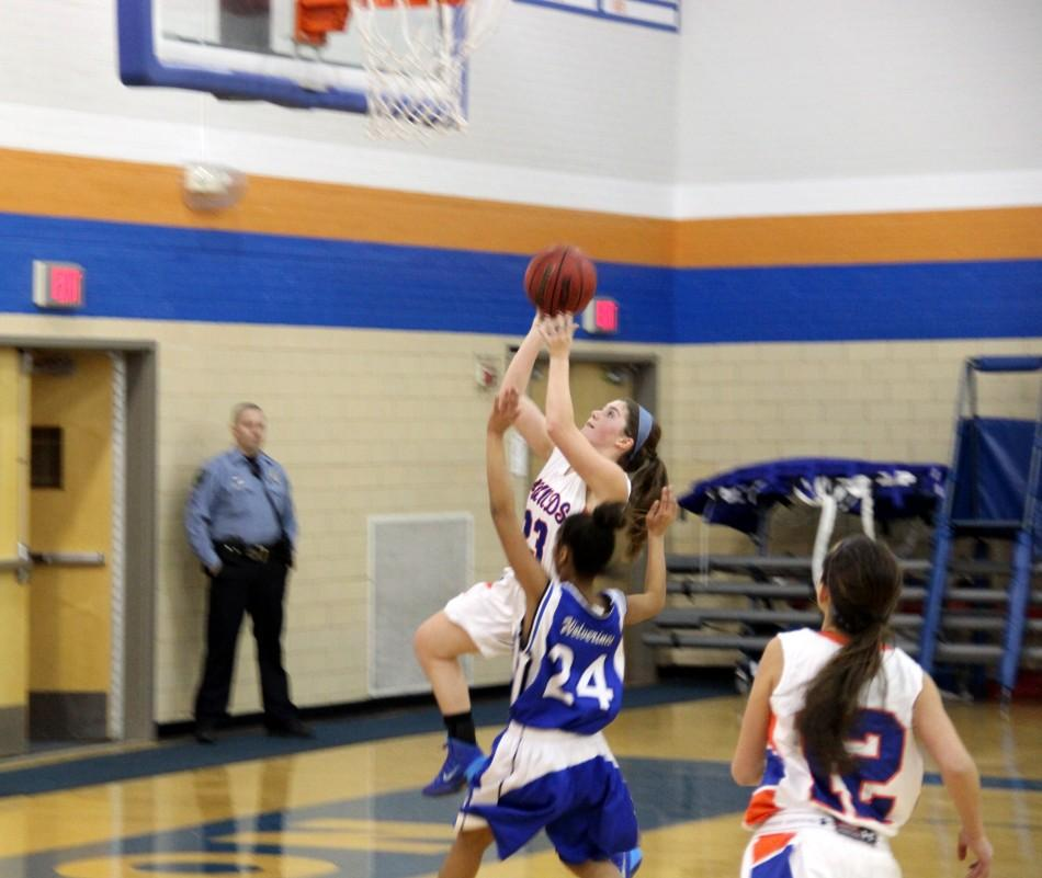 Junior Reeves Oyster makes a lay-up in Tuesdays Varsity Girls basketball game against Vashon High School.  The Lady Hounds led the entire game and finished with a winning score of 71-11.