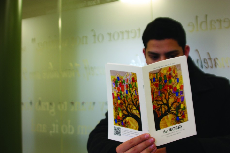 Senior Ketan Jain-Poster reviews the 2013 edition of the CHS literary magazine, The Works. The Works is nominated for the Pacemaker Award. Photo by Rebecca Stiffelman.