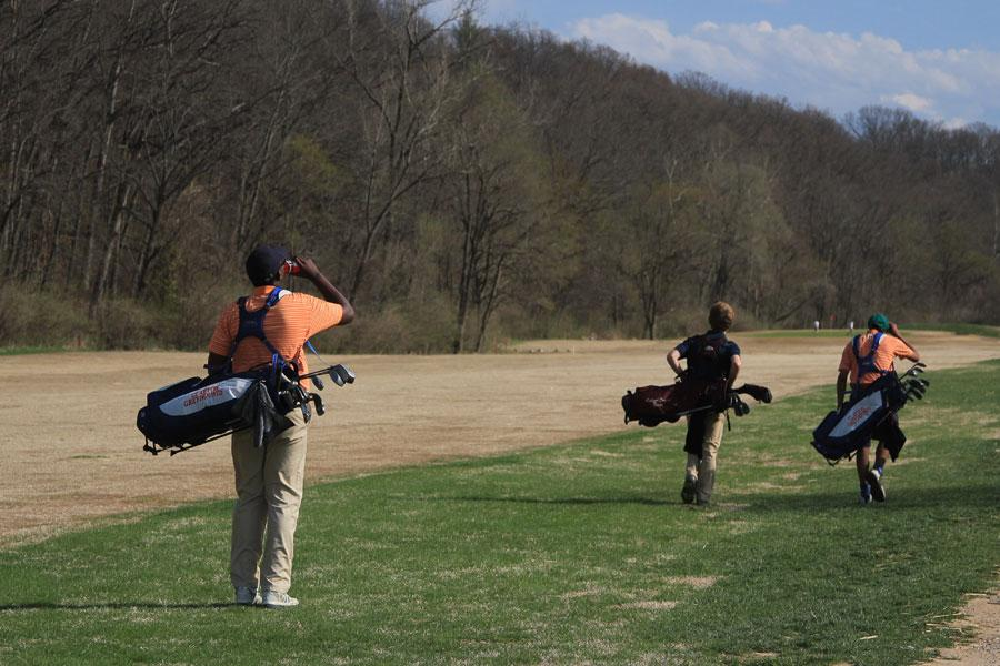 Matthew Helm (11) stops for a drink on the fairway during a JV golf meet against Rockwood Summit. The two teams played at Sugar Creek Golf Course on Thursday with Rockwood managing less strokes and getting the win.