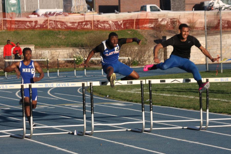 In this photo the Clayton Greyhound's 300 meter hurdle runner leaps the second set of hurdles in a dead heat race to the finish line. Support both the boys and girls track teams at their next meet at home on April 23rd.