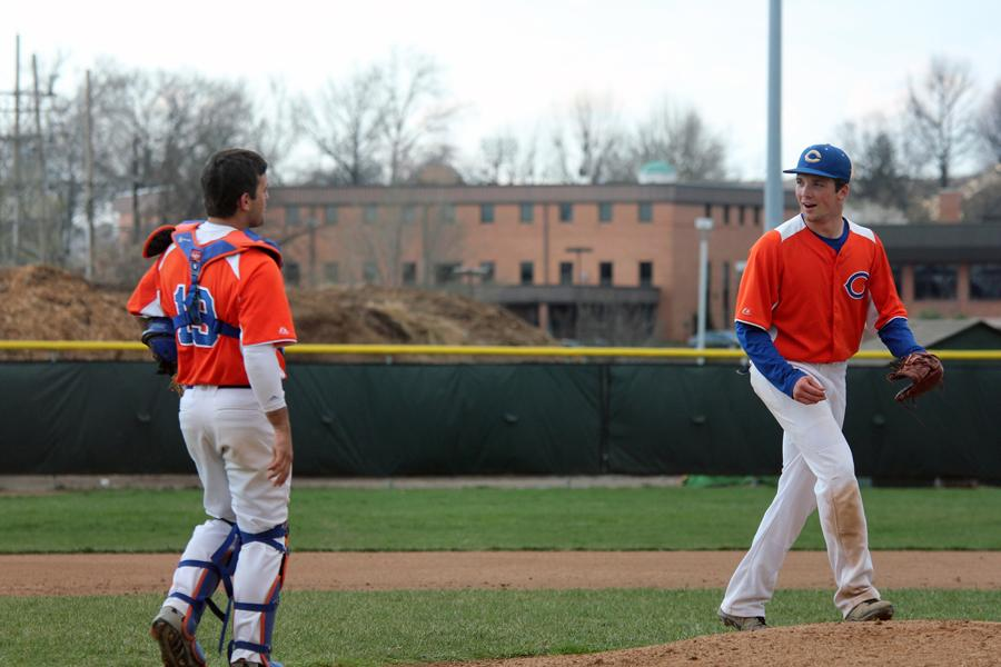 Catcher Jake Brown (11) exchanges words with pitcher John Howard (11) before the start of a new inning. Despite a strong start, Kirkwood pulled ahead toward the end of the game and got the win. Final Clayton 2 Kirkwood 3