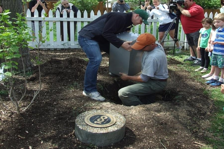 This photograph was taken at the Hanley House for the City of Clayton Centennial Time Capsule ceremony. The capsule won't be open until the year 2063. Inside are essays and photographs taken by Clayton students, as well as the 2013 City of Clayton budget.