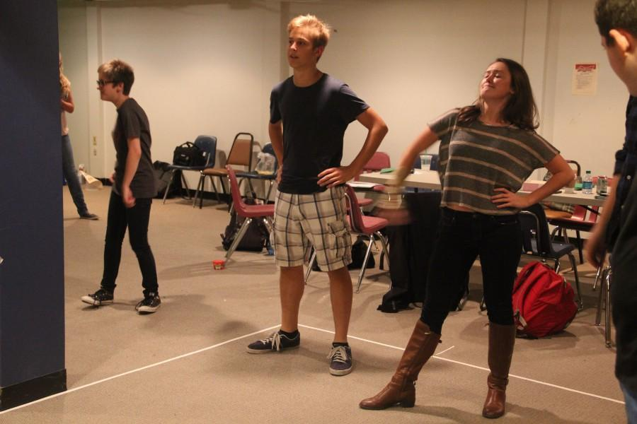 Adam Treutelaar warms up with the cast before beginning rehearsal.  (Leah Shaffer)