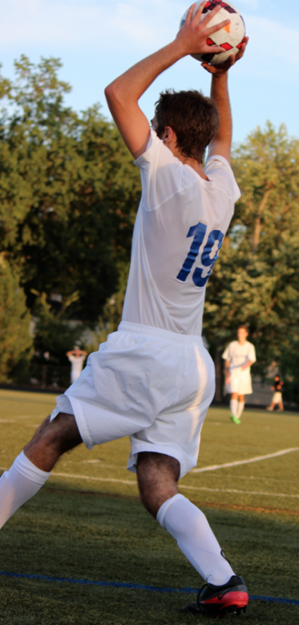 Tim Nonet throws the ball in at Clayton's home game against Vianney. The Hound's had a disappointing loss 2-0, but everyone played their hardest all the way until the end of the game.