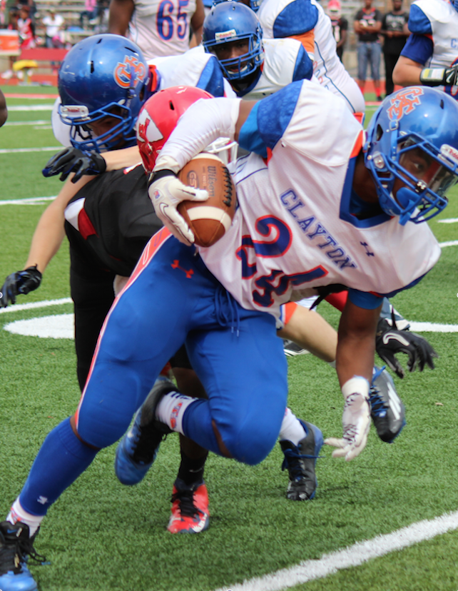 Junior Tyler Melvin dodges many Jennings players during Claytons game against Jennings at Jennings. Clayton had a close loss 34-21, but the game was very close throughout.