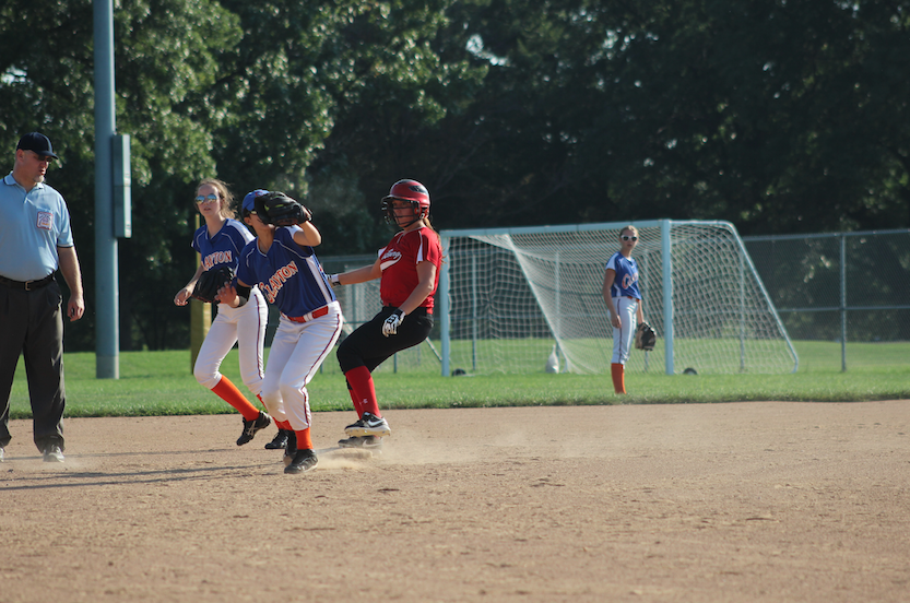 Softmore Anisa Miller going for the ball and scoring the third out.