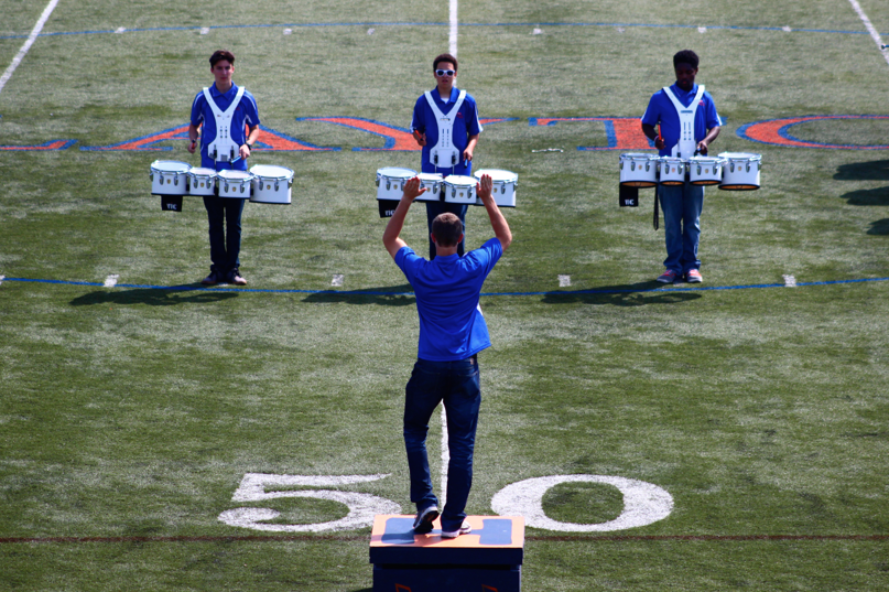 Senior Christopher Longman leads percussion in the halftime show of the Homecoming game.