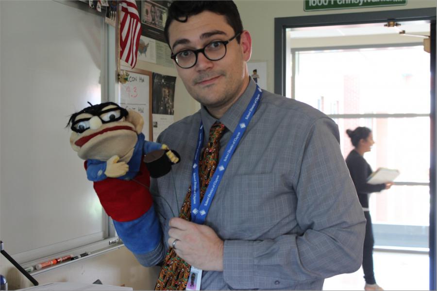 Mr. Glossenger holds the puppet of himself.