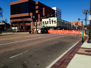 Barricades and police vehicles can be found along Central Avenue in downtown Clayton. (photo by Alex Bernard)