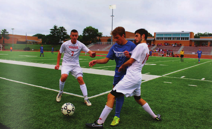 Junior Sam Schneider fights for the ball against Kirkwood. (Photo by Andrew Erblich)