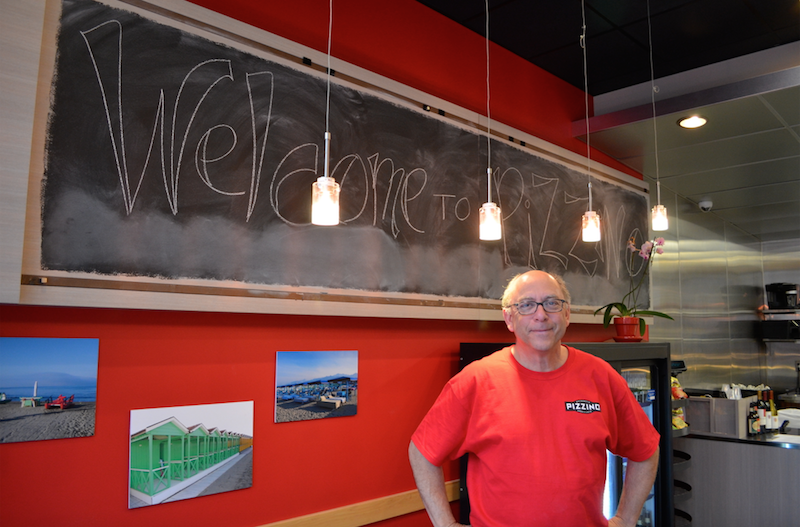 Jim Zimmerman, owner of Pizzino, in his restaurant.