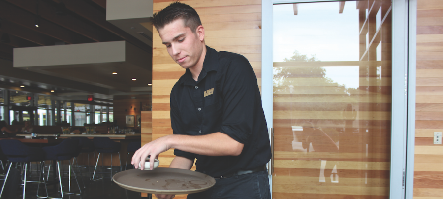 Snodgrass serving salsa at Cantina Laredo.