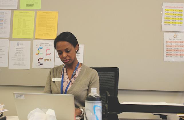 Merrills working at her desk (Felix Evans).