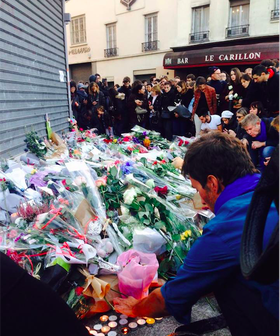 People surround the sites of the attacks with flowers, notes, and candles while mourning those who were lost.