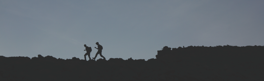 Soares and an HMI classmate run across a ridge at 13,000 feet while on a backpacking trip. (Peter Kernan)