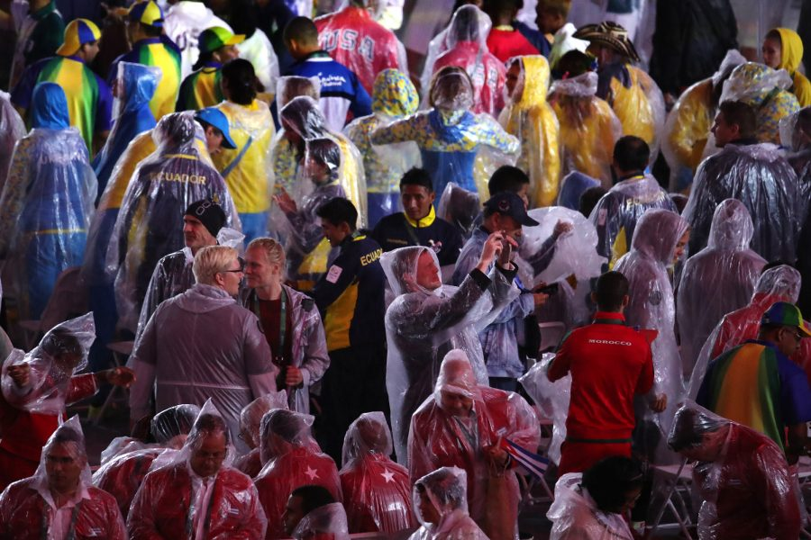 Athletes from numerous countries mingle in the rain as the Rio 2016 Closing Ceremony continues on Sunday, Aug. 21, 2016 at Maracan in Brazil. (Robert Gauthier/Los Angeles Times/TNS)