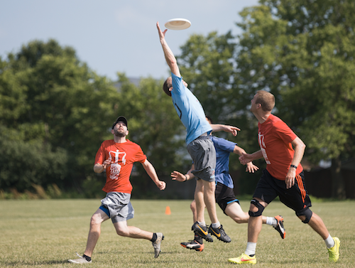 A Polar Vortex player, in blue, jumps to catch the frisbee during a game against FoG at Inwood Soccer Complex in Joliet, Ill., on June 25, 2016. (Brandon Chew/Chicago Tribune/TNS)
