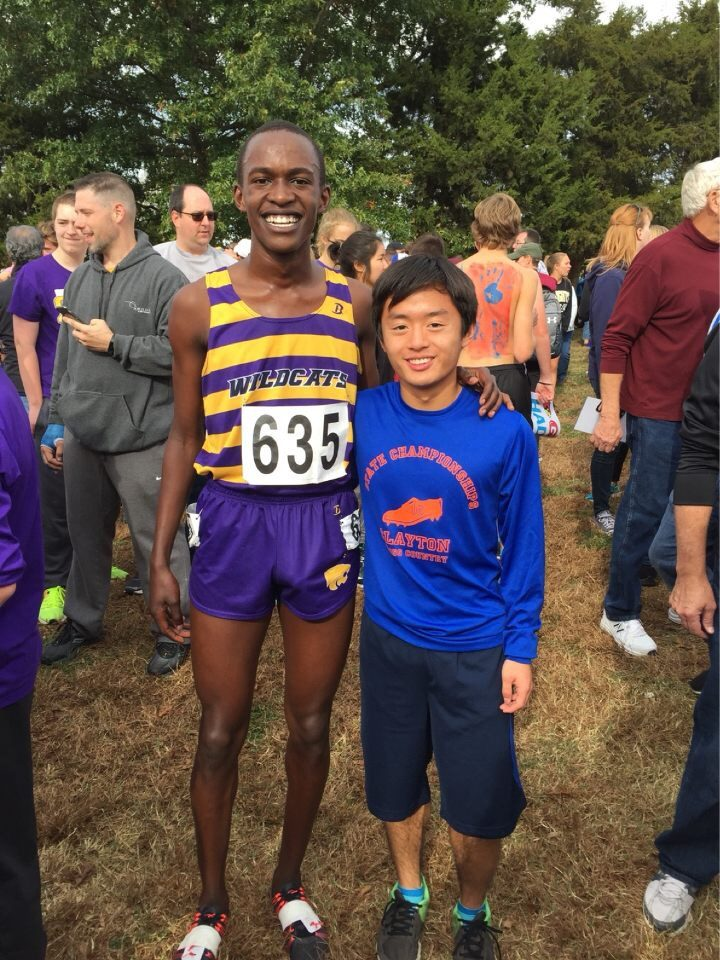 Andrew Wang stands with his first round draft pick, Blue Springs junior Victor Mugeche