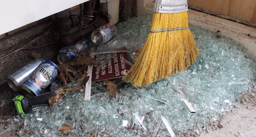 Broken glass, beer cans and other debris inside Maryland School. Photo by Katherine Sleckman.