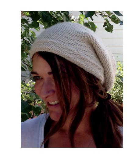 VonDras wearing a Rikke hat she knitted.