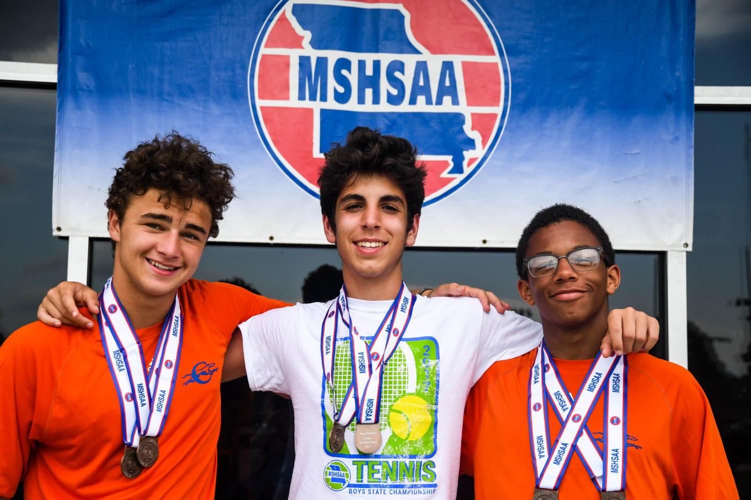 CHS boys' varsity tennis team after state tournament.  Erik James (left), Noah Brown (middle), and Angelo Vidal (right).  Photo by Michael Melinger.