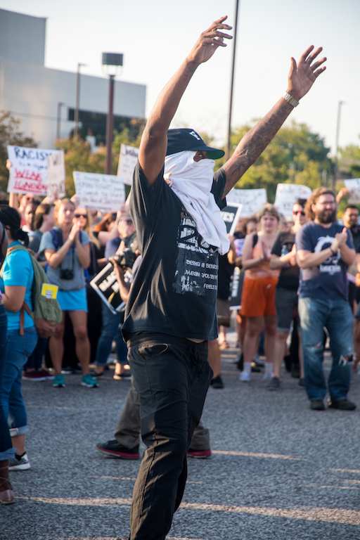 A+protester+in+the+crowd.+Photo+by+Michael+Melinger.