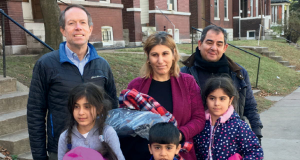 Photo of Charlie Brennan and a Syrian family.