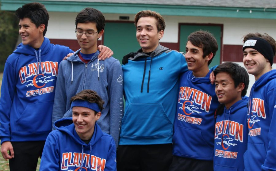 The boys' cross country team just after finishing their district race
