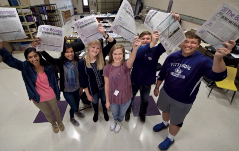 Pittsburg (Kan.) High School student journalists Trina Paul, from left, Gina Mathew, Kali Poenitske, Maddie Baden, Patrick Sullivan and Connor Balthazor hold up copies of The Booster Redux on Wednesday, April 5, 2017, containing their article that led to the resignation of the school's newly hired principal. (Keith Myers/Kansas City Star/TNS)