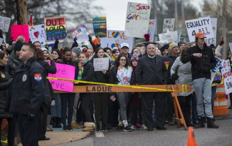 John Burroughs students and members of the community rally in defense for star football player, Jake Bain, who recently came out as gay. The students and members of the community protest on Clayton Road against Westboro Baptist Church.
