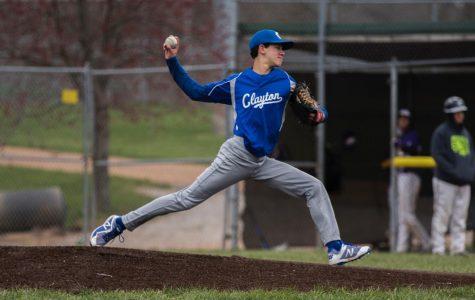 Photo of Sophomore Samuel Siwak pitching.