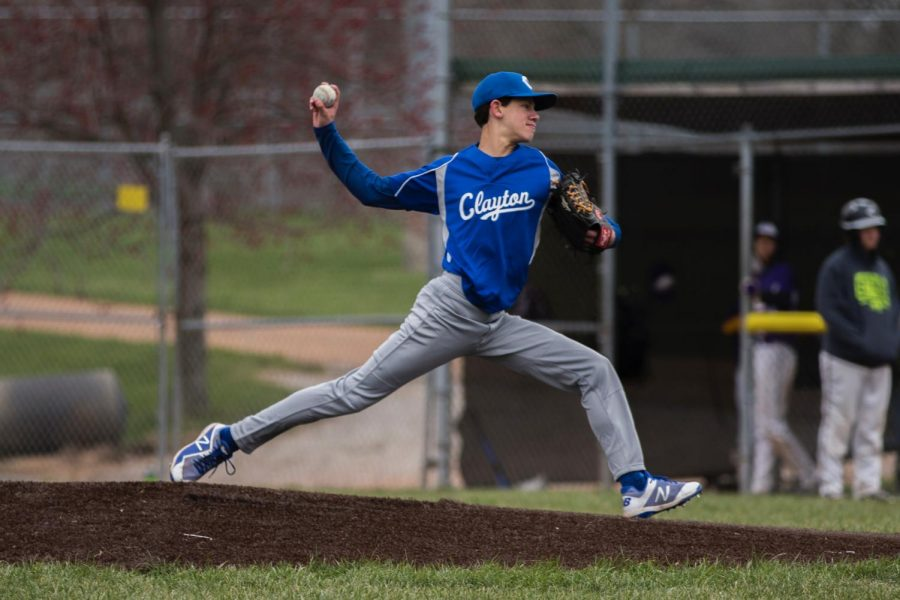 Photo of Sophomore Samuel Siwak pitching.
