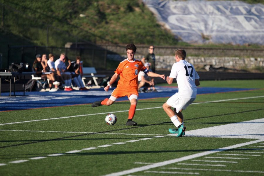 Dulle (8) moves to kick the ball past an opponent from Pattonville during their game on Sep. 12. The hounds defeated Pattonville and won the game 6-1.