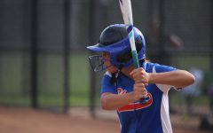 Sophomore Olivia Zindel prepares to swing in a girls' varsity softball game.