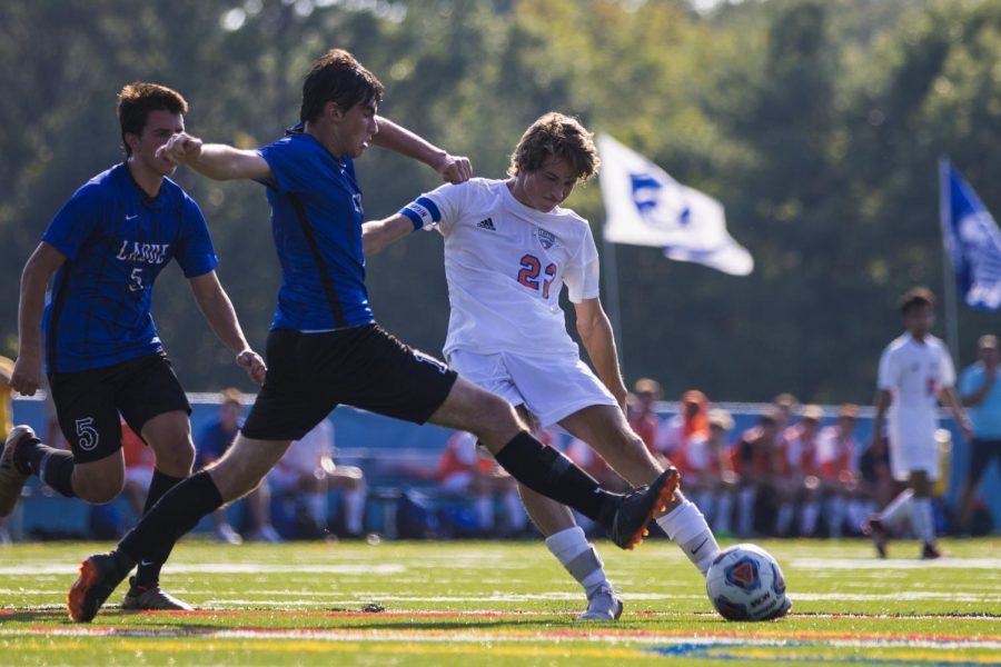 Senior Max Boeger dribbles by Ladue defender