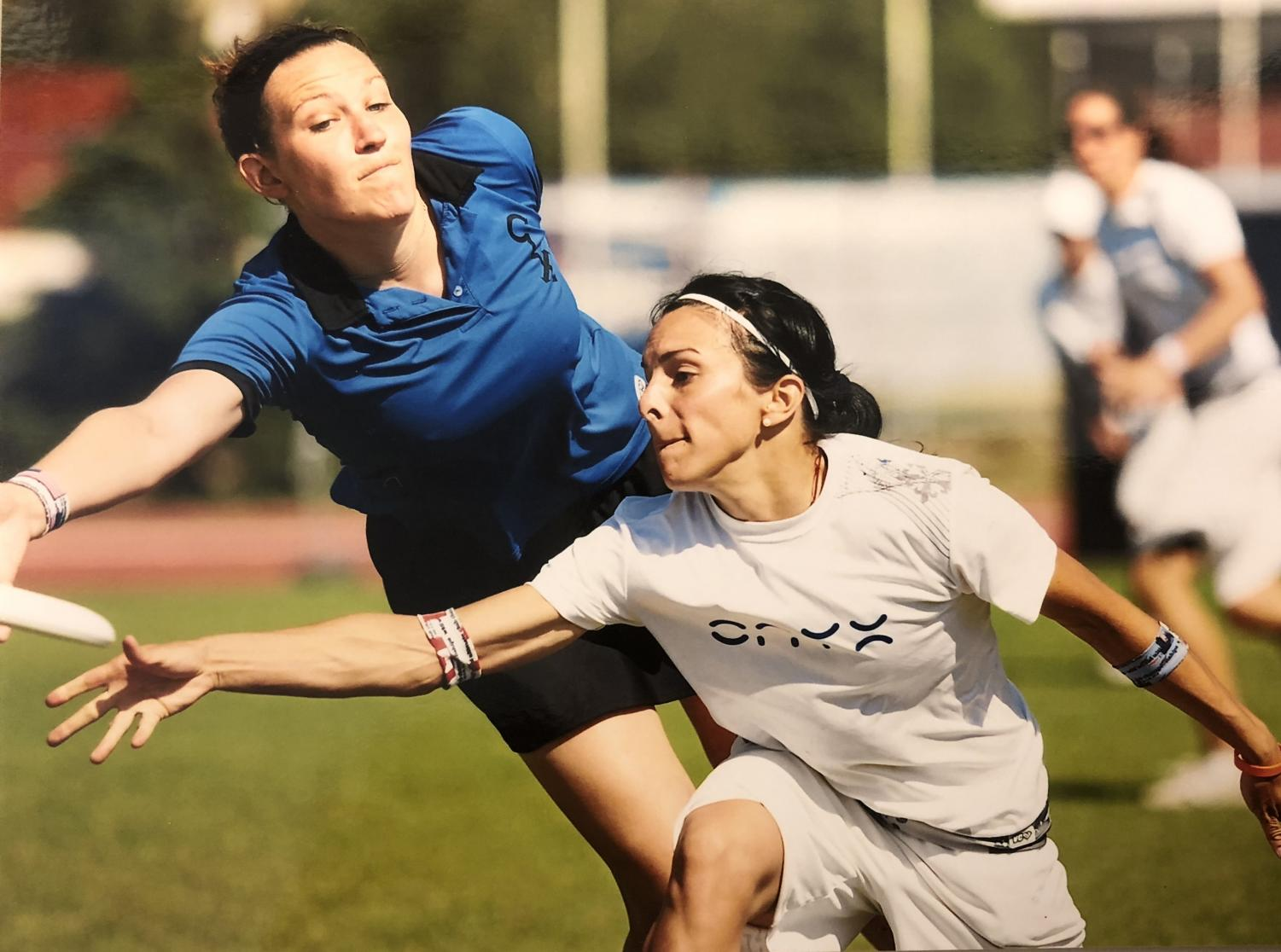 Lyons (left) dives for the disc during an Ultimate Frisbee tournament. Her team, called the Chad Larson Experience, took first out of 40 teams at the 2010 World Ultimate Club Championships in Prague.