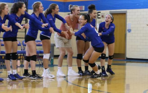 The girls' varsity volleyball team hypes themselves up just before a game. The inclusive policy of volleyball and other Clayton sports has come into question recently as the athletic participation policy changed.