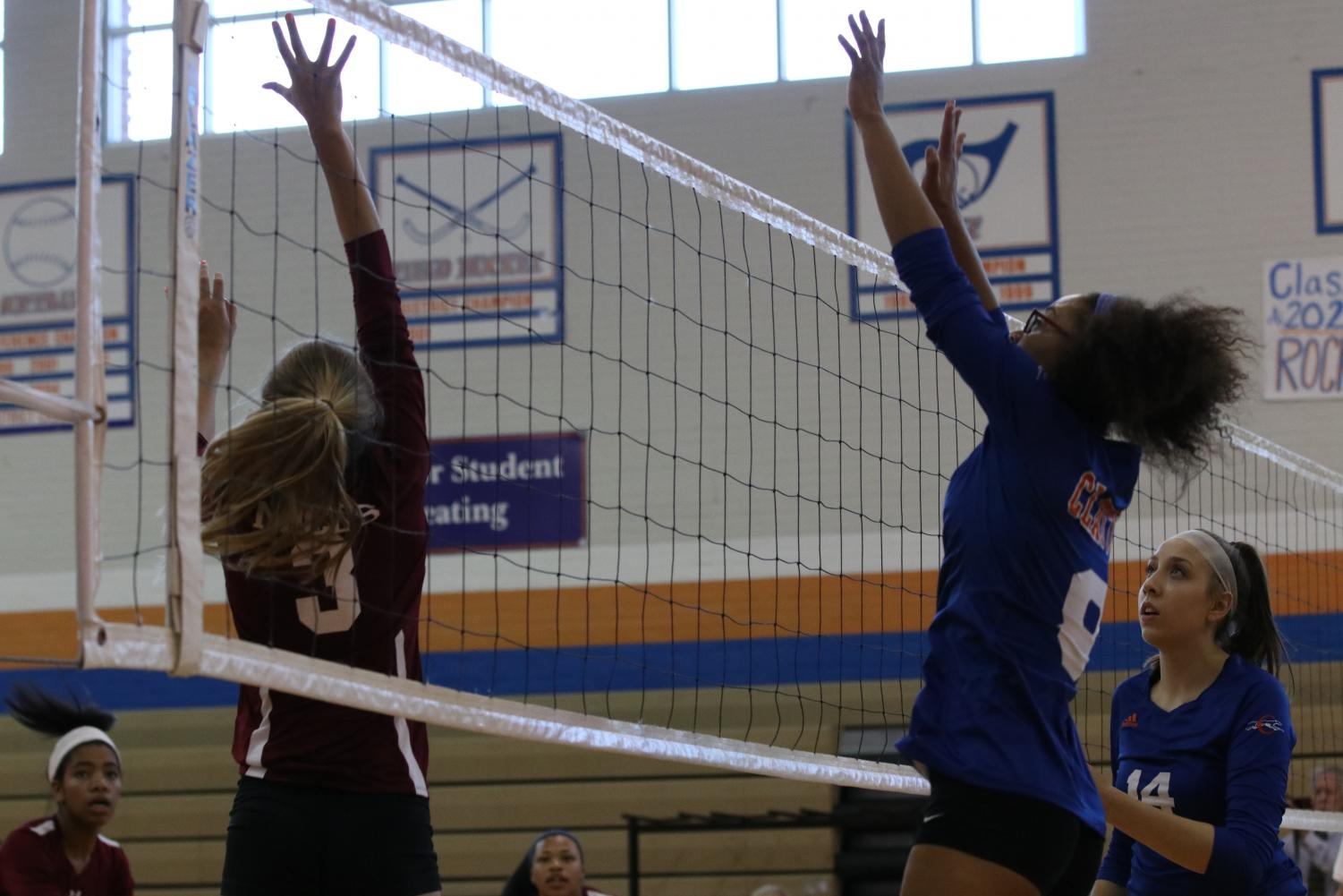 Sophomore Sophia Boyd blocks a hit during a game.