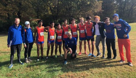 The boys' varsity cross country team poses just a few minutes after all completing the District 5k race in personal record times. Shortly after, the hounds were awarded first place in the district and advanced to the State Championship.