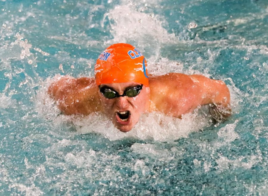 A swimmer from the boys' varsity swim team competes during their senior night match against Burroughs. The hounds won the meet.