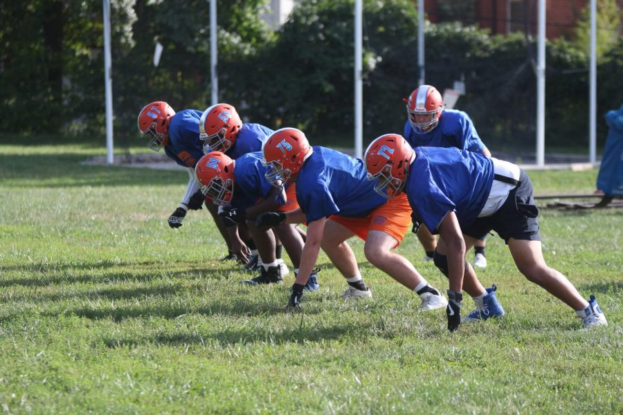 The Greyhounds work on a new play during a practice at Gay Field.