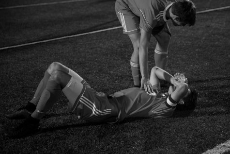 Clayton Greyhounds midfielder James Dulle (8) is comforted by a teammate after the Greyhounds 2-1 loss during the district championship match of the Class 3 District 5 MSHSAA tournament against the Ladue Rams on October 31, 2018 at Centene Stadium in St. Louis, MO.